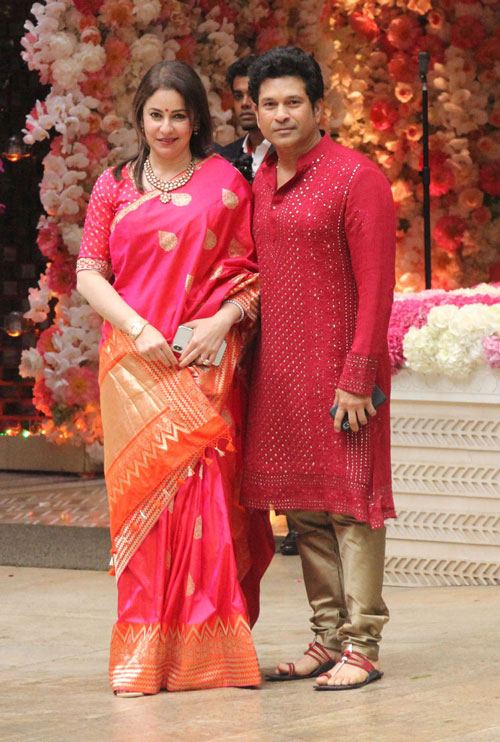 Sachin Tendulkar and his wife Anjali Tendulkar pose together as they arrive for Akash Ambani and Shloka Mehta