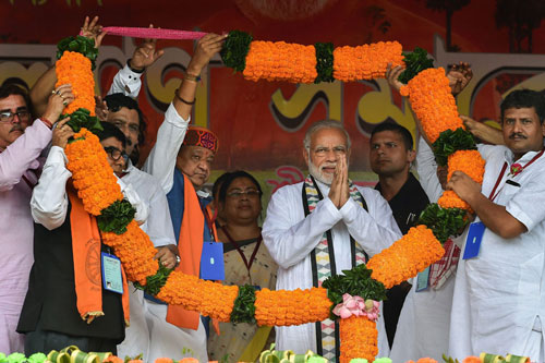 Prime Minister Narendra Modi being garlanded during