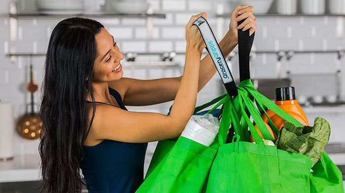 8. Give your hands a break and conveniently carry all your shopping bags at once with Grocery Gripps! These handy straps distribute all the weight on your wrist or shoulders making it easier to carry the load. It