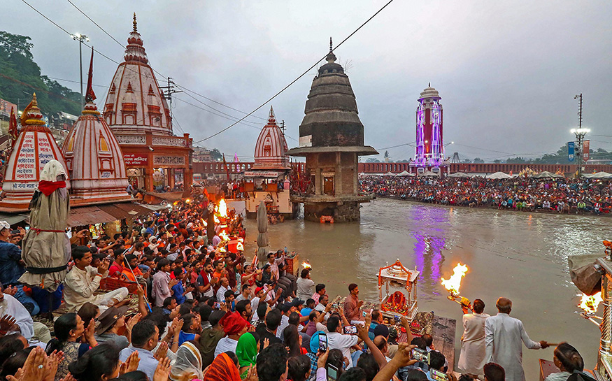 Temple priests and devotees perform aarti on Har Ki Pauri on the bank of River Ganga, in Haridwar.