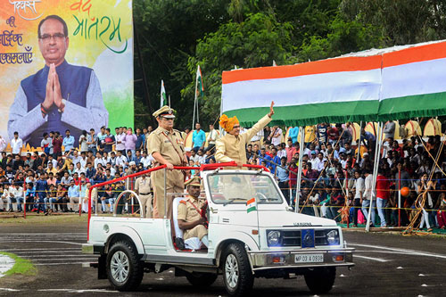Madhya Pradesh Chief Minister Shivraj Singh Chouhan waves at the crowd during 72nd Independence Day celebrations at Motilal Nehru Police Stadium in Bhopal.