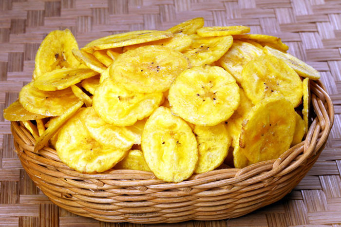 "Banana Chips: Banana chips are deep-fried and/or dried slices of bananas (fruits of herbaceous plants of the genus Musa of the soft, sweet ""dessert banana"" variety). They can be covered with sugar or honey and have a sweet taste, or they can be fried in oil and spices and have a salty and/or spicy taste."