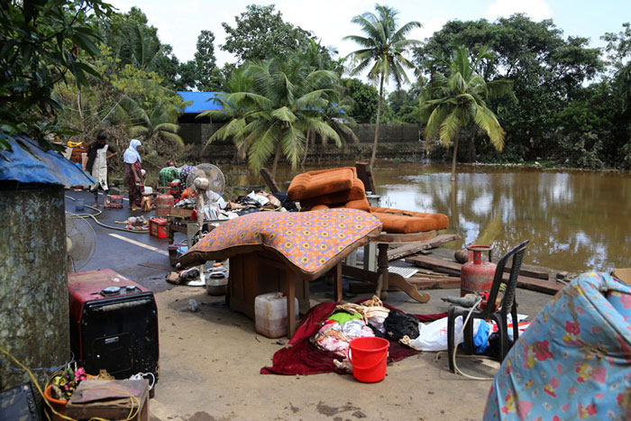 Household goods are placed on road to dry after being salvaged by residents from their flood affected houses in Kochi.