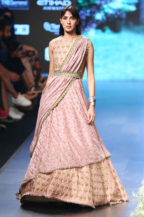 10. For a modern look, cinch your lehenga set with a belt.