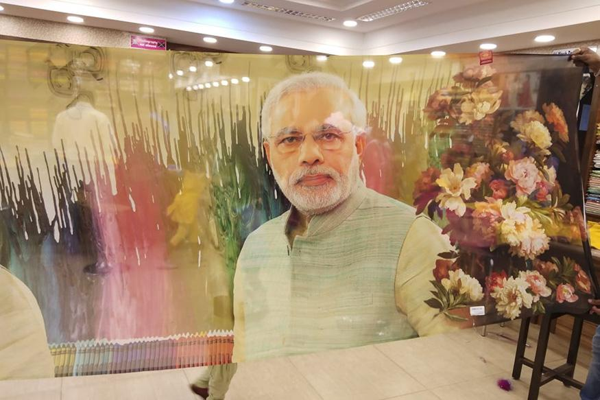 A sari with a printed image of Prime Minister Narendra Modi is displayed at a shop in Udupi.