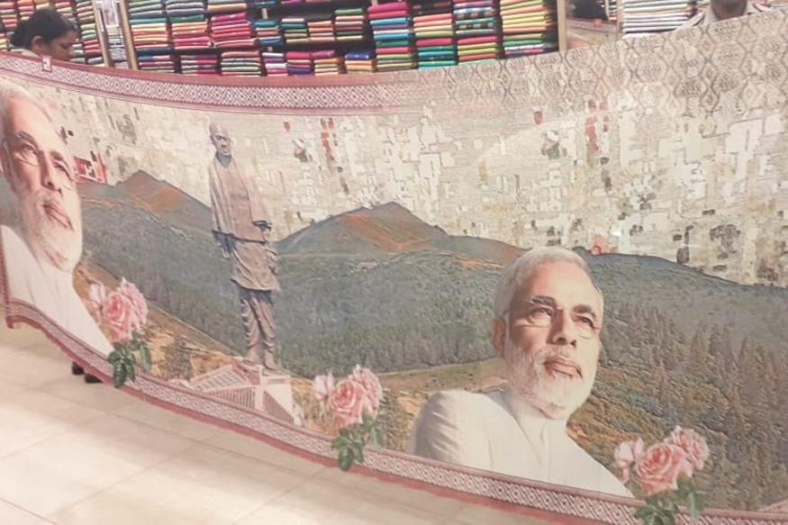 A sari with printed images of Prime Minister Narendra Modi and Vallabhbhai Patel is displayed at a shop in Udupi.