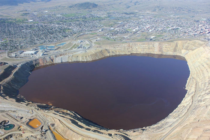 Berkeley Pit, Butte, Montana This pit used to be a copper mine and is now filled with highly acidic water. That's how it gets that weird, dangerous-looking color. It's about 1780 feet deep, give or take a few.