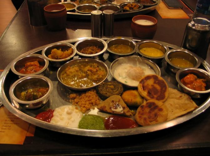 9. Rajasthani Thali From gatte ki sabzi to daal-baati churma to khichda to laal maas to bajre ki roti to lahsun ki chutney... to... well, you get the point. The Rajasthani thali is the qunitessential Indian thali. You have stellar dishes like the mawa kachori from Jodhpur, juicy sweet rasgulle from Bikaner and malpuas from Pushkar. tasty treats from every nook and cranny of Rajasthan come together on plate for a food experience of a lifetime.