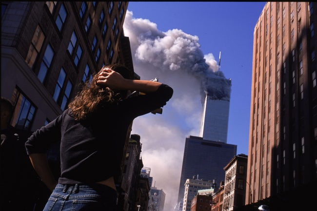 Shocked New Yorkers Observe The Burning Towers