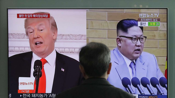 A man watches a TV screen showing file images of U.S. President Donald Trump, left, and North Korean leader Kim Jong Un, right, during a news program at the Seoul Railway Station in Seoul, South Korea, Tuesday, March 27 - PTI