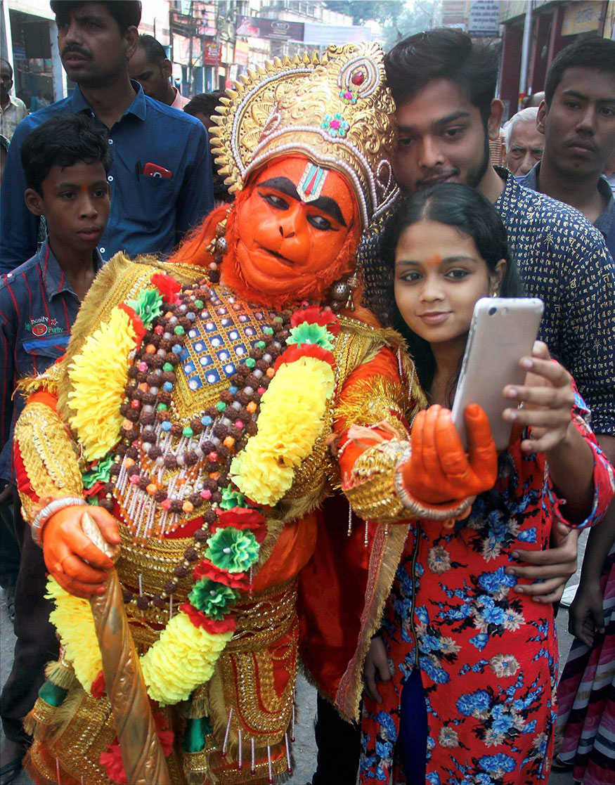 A devotee takes a selfie with a boy dressed as Lord Hanuman during the Hanuman Jayanti procession in Allahabad.