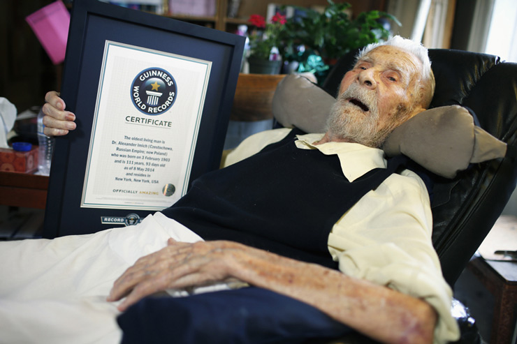 111-year-old Alexander Imich holds a Guinness World Records certificate recognizing him as the world