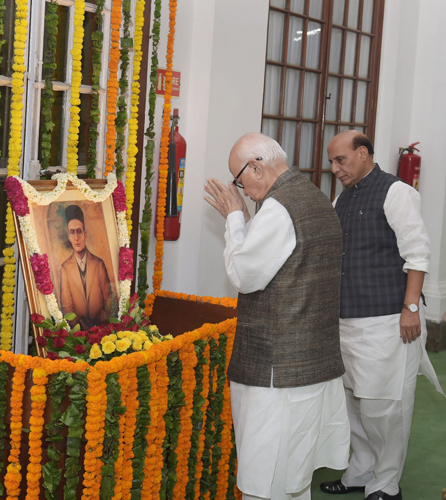New Delhi: Senior BJP leader L K Advani paying floral tribute to Vinayak Damodar Savarkar on his birth anniversary at Parliament house in New Delhi on Monday. Home Minister Rajnath Singh also seen in the picture.