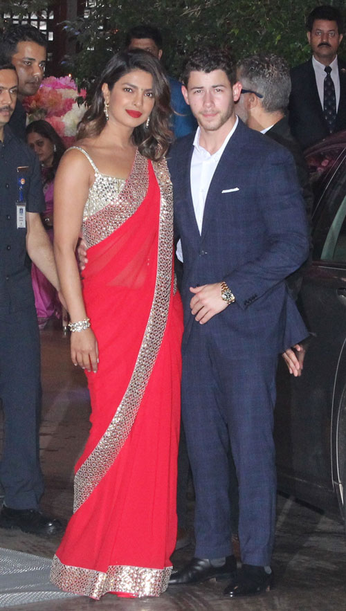 Priyanka Chopra and Nick Jonas pose together as they arrive for Akash Ambani and Shloka Mehta