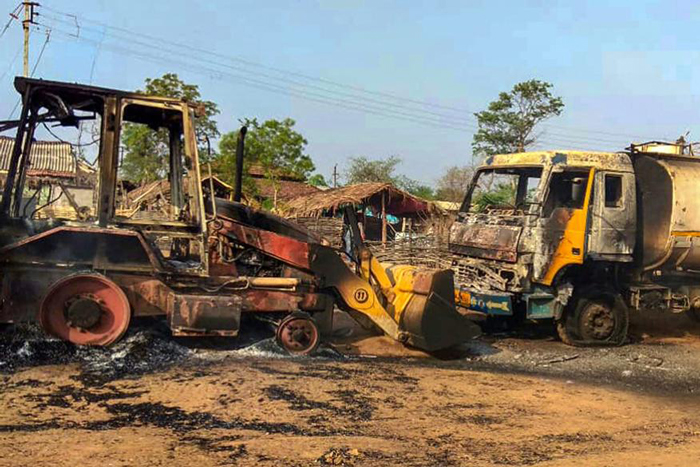 Charred vehicles which were allegedly torched by Maoists, at Kukheda town in Gadchiroli district in Maharashtra
