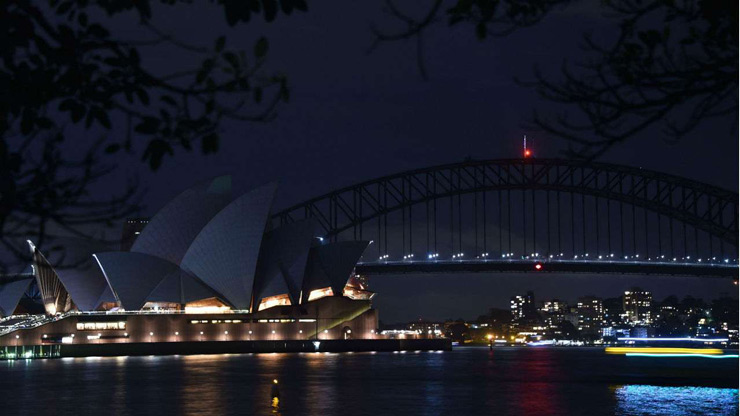 Sydney Harbour Bridge and the Opera House are plunged into darkness for the Earth Hour environmental campaign.