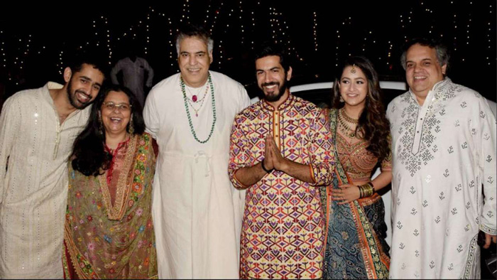 Designer duo Abu Jani and Sandeep Khosla posed with newly weds Saudamini Mattu and Siddharth for the paparazzi.