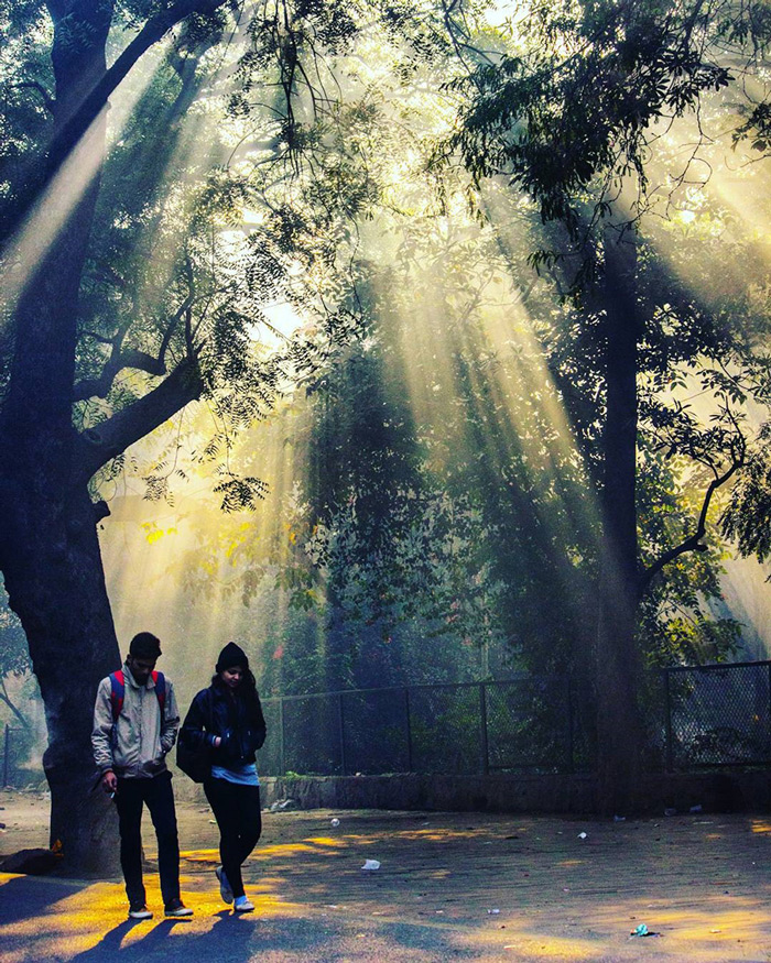 A couple enjoying a stroll at a park in New Delhi.