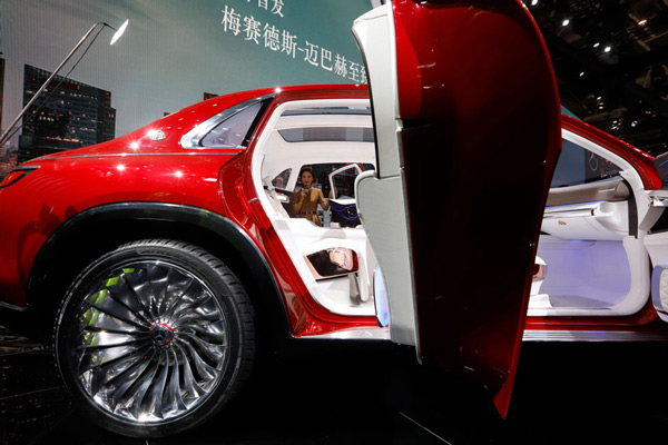 A presenter looks through the white interior of the Mercedes-Maybach Vision displayed at the Auto China 2018 show held in Beijing, China.