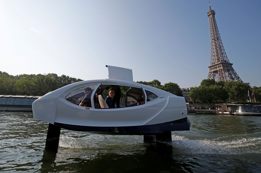 The Bubbles water taxi flies above the surface of the Seine River during a demonstration by the SeaBubbles company in Paris, France.