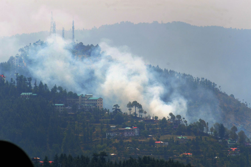 Shimla: Smoke rises after a forest fire broke out during the ongoing hot weather conditions, in Shimla, on Monday, May 28, 2018.
