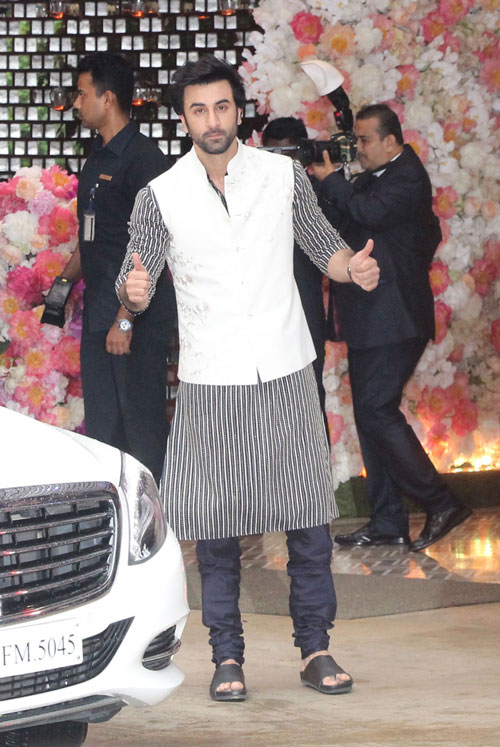 Ranbir Kapoor gestures for the cameras on his arrival at Akash Ambani and Shloka Mehta