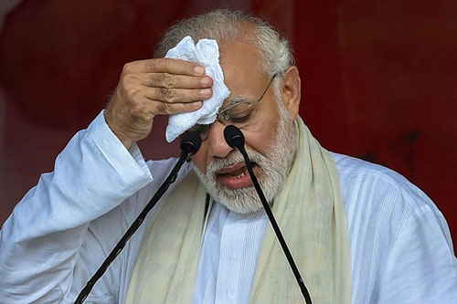 Prime Minister Narendra Modi reacts during his address for